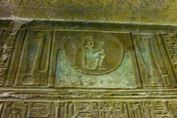 Hathor sat in the Akhet sign with her sistrum, and between the two Menat collars of protection Denderah temple by Antoine Gigal